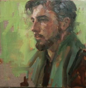 Man with green scarf